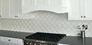lantern style tile backsplash arabesque design