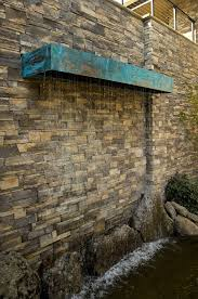stone with floating shelf and plans on creating a water feature in your garden oregonlive com water wall