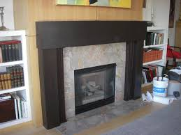 marble fireplace surround and wooden mantle by stone center inc