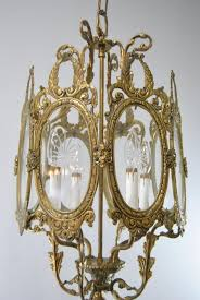 antique bronze chandelier with 4 candle light sockets