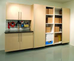 custom wood wall mounted garage storage cabinet design with sliding door stainless steel handle and small pegboard above workbench ideas