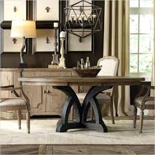 dark wood round dining table furniture with leaf and chairs uk