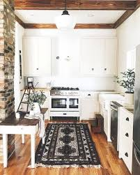 farmhouse style kitchen rugs are really trendy right now and can really warm up a space