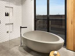 Image of: Rustic Bathroom Interior With Oval White Standing Stone Tub And  Pertaining To Standalone