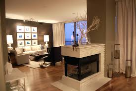 gorgeous gas insert double sided fireplace modern style with white stones paneling also laminate wooden flooring