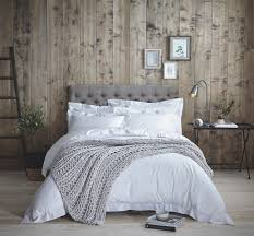 combine crisp white cotton bedding with heavy throws and cushions for a layered look you d love to cuddle in to