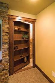 • the world s catalog of ideas basement hidden storage the bookcase is a secret door that hides storage ©finished basement