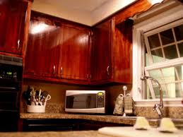 Refinish Stained Wood How To Give Your Kitchen Cabinets A Makeover Hgtv