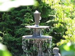 create the effect of an expensive fountain for your garden at a fraction of the cost by making one from parts found in thrift s