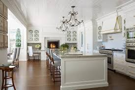 fireplace in kitchen. gourmet kitchen with raised white brick fireplace in