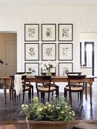 love the art wall of framed botanical prints. You can go with more neutral  colors and large mats.