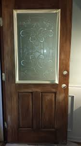 it s easier to insset decorative glass into a cut out area while the door is hung