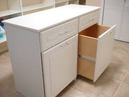 laundry room furniture. White Wooden Laundry Room Folding Table With Two Top Drawers And Low Pulled Out Storage On Cream Tile Flooring Furniture