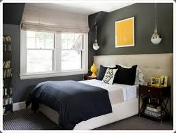 white and grey bedroom furniture. Bedroom:Small Grey Bedroom With White Comfort Bed And Black Pillows Near Brown Wood Nightstand Furniture