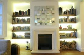 built in shelves around fireplace small living room with book rack and fireplace with built in