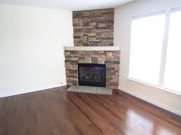 upgrade old corner gas fireplace with stone posted trina corner stone fireplace