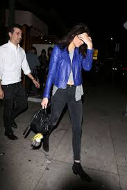 kendall jenner in blue jacket and jeans 14