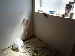 getting ready for tiling plaster board the bathroom walls