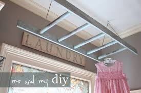 I had seen several photos of this ladder on Pinterest, and adapted the idea  to fit the space I had in my laundry room.