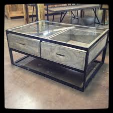 Elongated bronze bar pulls add the finishing touch. Glass Top Coffee Table With Drawers Nadeau Dallas