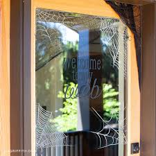 Any visitor will think twice before knocking on your door. Spiderweb Window Clings For Halloween Lia Griffith