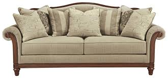 Transitional Sofa with Camel Back and Showood Trim by Signature