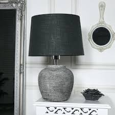 grey round table rustic stone lamp slate mats