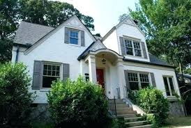 yellow house black shutters black shutters red door white yellow house black shutters red door brick