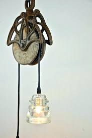 fantastic glass insulator lights insulator lamps pendant with reclaimed barn pulley glass insulator lights telephone insulator
