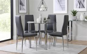 gallery solar round chrome and glass dining table with 4 leon grey chairs