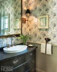 new england style bathroom cabinets. sandberg wallpaper from stark graces a guest bath. new england style bathroom cabinets