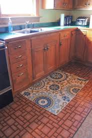 even a small area rug near the sink can add a punch of design to a ho hum vinyl floor if the rug you choose doesn t have rubber backing