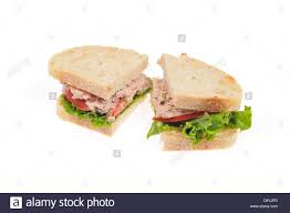 Tuna Mayo Sandwich On White Bread With Lettuce And Tomato Cut In
