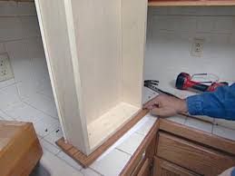 install door shock absorbers inside each cabinet