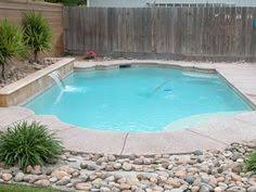 Pool Landscaping - Simple with rocks and native plants!! @Stacey Schrank