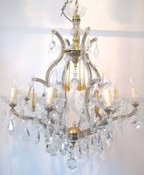 an 8 arm marie therese chandelier decorated with clear lead large drops and amber teardrops in the middle this a great cage shape marie therese and would