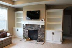 cabinets next to fireplace. Built In Media Cabinet Next To The Fireplace Would Be Nice But You Can Always Use Piece Of Freestanding Furniture That Fits Inside Cabinets