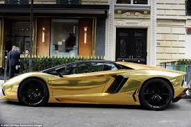 lamborghini aventador black and gold. the car which is valued at around 4 million and appears to be from lamborghini aventador black gold