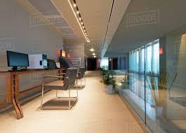 office hallway. Empty Desks In Modern Office Hallway