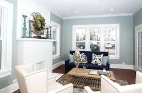 light gray and white living room with painted brick fireplace wood flooring paint colors ideas grey sofa