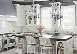contemporary luxury kitchen with hanging crystal chandeliers and breakfast bar island