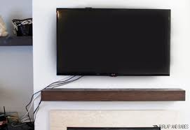 TV mounted on wall image.