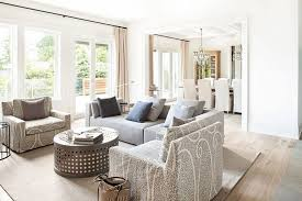 modern farmhouse living room decoration luxury sofa set throw pillows accent unique round table beige carpet chandelier lamp
