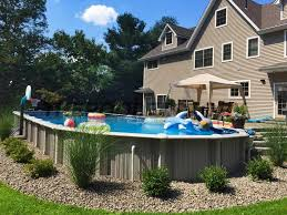 Farmhouse Ideas With Large Above Ground Pools And Stone Walkway And