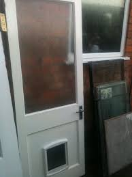 exterior wooden door with large glass panel and dog flap