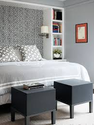 Storage ideas around the headboard wallpaper headboard. This is a whole  different take on those hideous built ins! Like stools at foot of bed too.