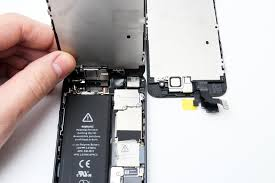 notice our replacement screen on the right and the fact there are three connector cables these are under the top metal plate inside our phone