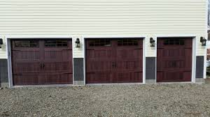 5916 c h i 2 9x7 1 6x7 long panel gany carriage house door with 2 2 piece arched stockton windows