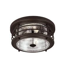 sea gull lighting sauganash 2 light outdoor antique bronze ceiling flushmount with clear seeded glass