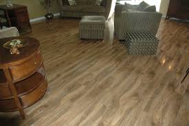 exotic walnut armstrong laminate flooring with armchair and ottoman for home decoration ideas